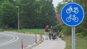 Family outing on the well defined cycle path from Germany into Holland